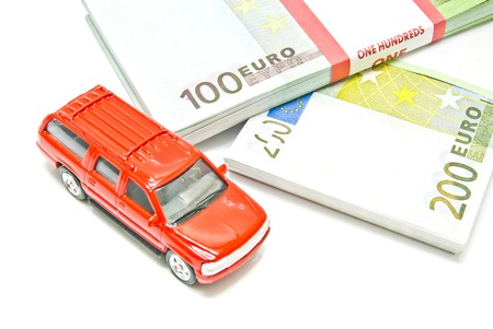 afford: red car on euro notes on white Stock Photo