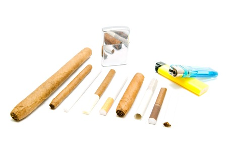 different cigarettes and various lighters on white