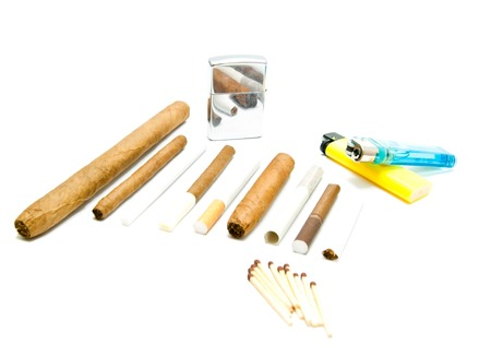 various cigarettes, matches and lighters on white background closeup Stock Photo