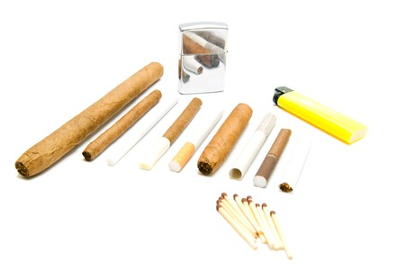 various cigarettes, matches and lighters on white background Stock Photo