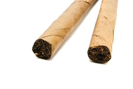 some Cuban cigars closeup on white background photo