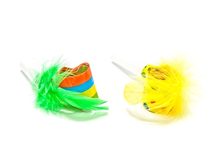 past midnight: two festive whistles with feathers on white background