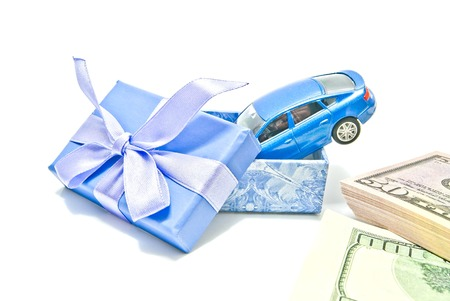 blue gift box: blue gift box with car and money on white