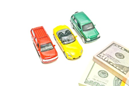 afford: three cars and dollar notes on white background