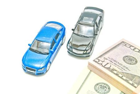 afford: blue and black cars near the bills
