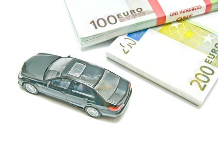 afford: black car on euro notes closeup on white background Stock Photo