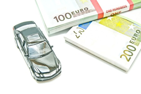 auto leasing: black car on euro notes on white background