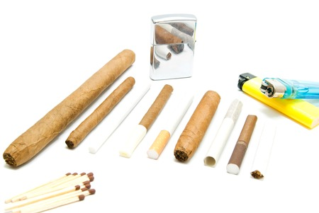 match head: matches, cigarettes and various lighters on white closeup