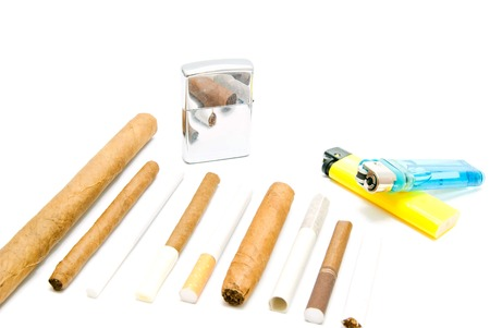 different cigarettes and various lighters on white closeup