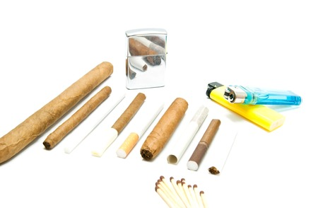 various cigarettes, matches and lighters closeup on white background