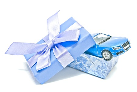 blue gift box: single blue gift box with car on white