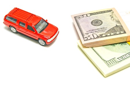 afford: single red car and dollar notes on white background Stock Photo