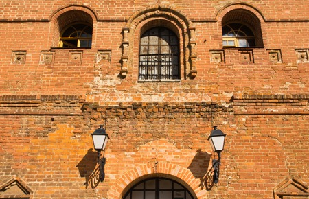grates: Street lamp on the wall of an old brick building Stock Photo