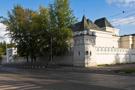 sidewalks: Road next to the old white stone monastery