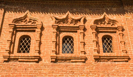 grates: three windows in an old brick manor park