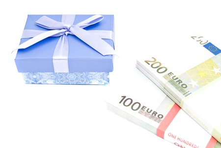 blue gift box: blue gift box and banknotes closeup on white background Stock Photo