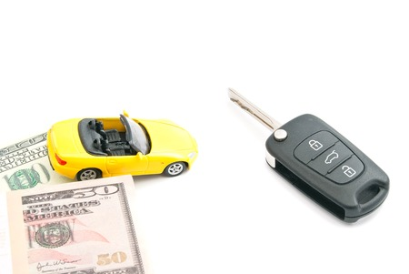 afford: keys, notes and yellow car on white closeup