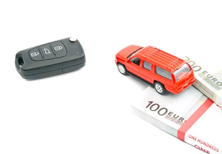 afford: red car with keys and money on white Stock Photo