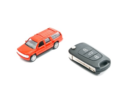 afford: keys and red car on white background
