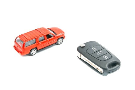 auto leasing: red car and keys closeup on white background