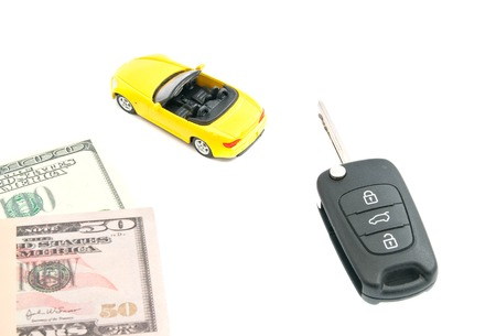 yellow car: keys, notes and yellow car on white