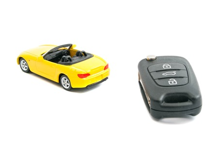 afford: keys and yellow car on white background