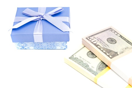 blue gift box: blue gift box and money closeup on white