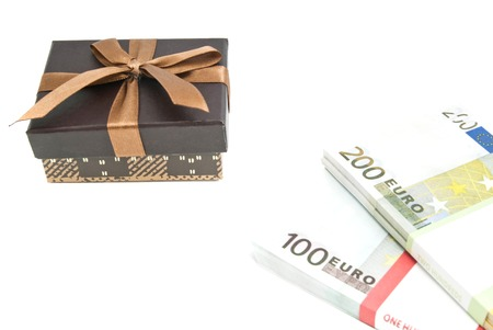 banknotes and brown gift box on white