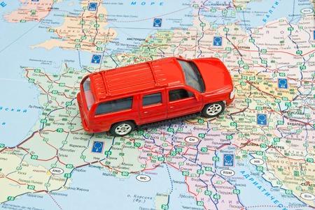 europe closeup: red car on the map of Europe closeup