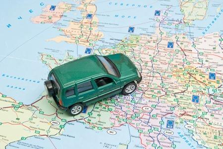 europe closeup: green car on the map of Europe closeup Stock Photo
