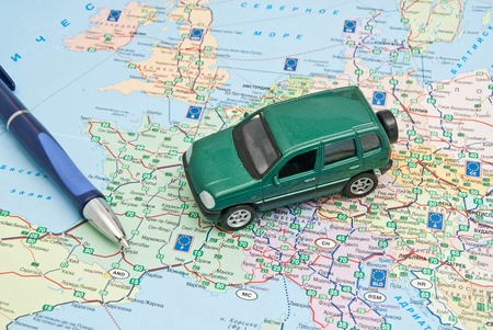 green car and pen on map of Europe Stock Photo