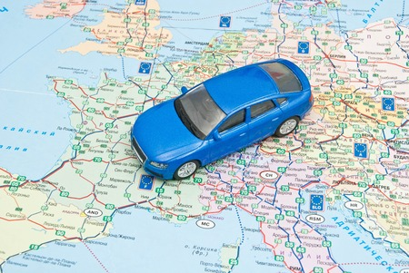 europe closeup: blue car on the map of Europe closeup