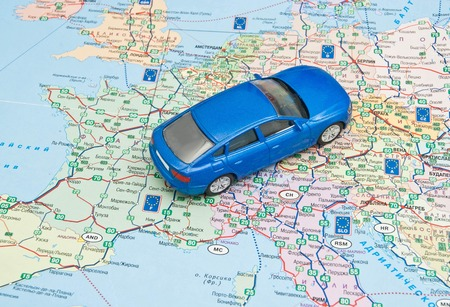 blue car on the map of Europe
