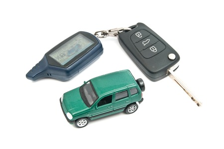 auto leasing: green car and keys closeup on white background