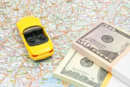 money and yellow sport car on map of Europe