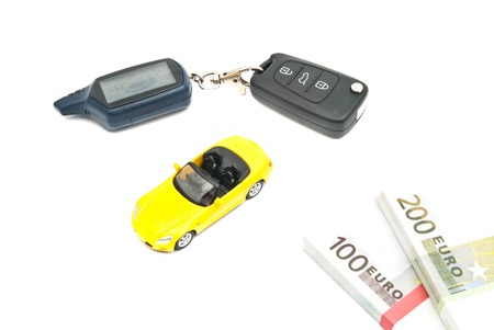 yellow sport car, keys and banknotes on white