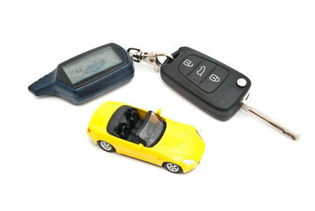 afford: yellow car and keys on white background
