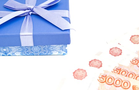 blue gift box: blue gift box and banknotes on white background