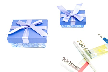 two blue gift boxes and banknotes on white background