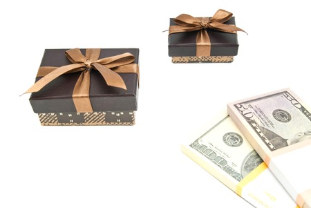 closed ribbon: two brown gift boxes and banknotes on white closeup