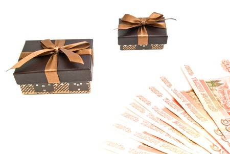 closed ribbon: two brown gift boxes and banknotes on white