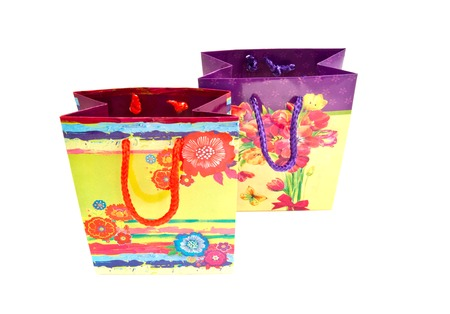 two colored gift bags on white background
