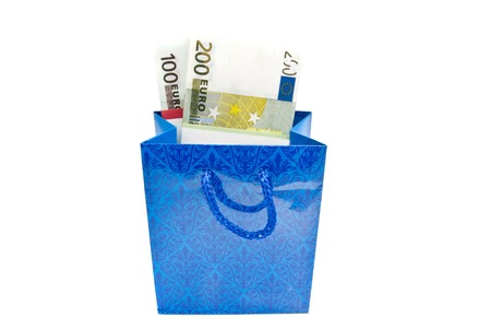 blue gift bag with money closeup on white