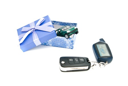 car keys, green car and blue gift box on white Stock Photo