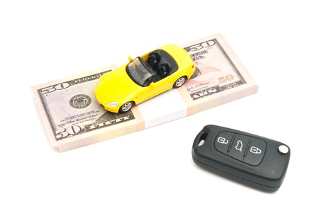 afford: car keys, sport car and banknotes on white Stock Photo