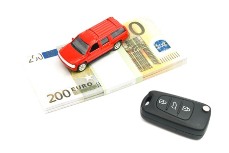 car keys, red car and banknotes on white background Stock Photo
