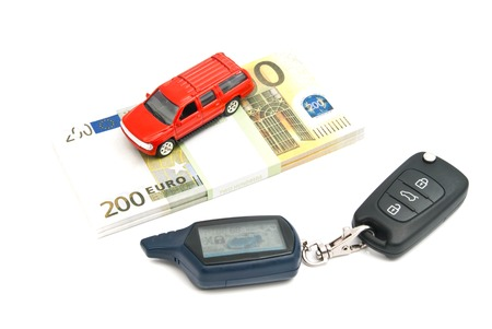 car keys, red car and banknotes on white Stock Photo