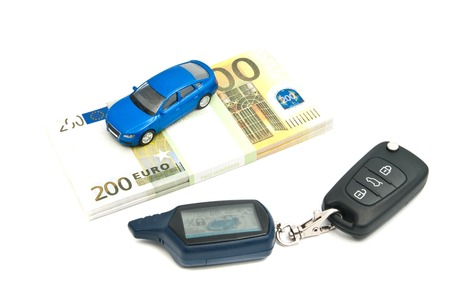car keys, blue car and banknotes on white