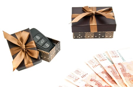 car keys, banknotes and brown gift boxes on white background