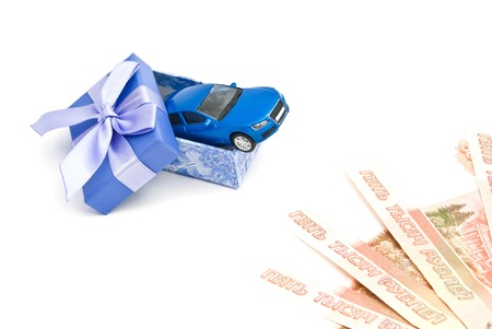 blue gift box: blue car in blue gift box and banknotes on white